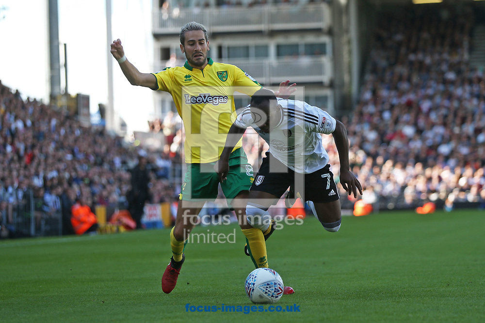 Neeskens Kebano of Fulham is fouled by Mario Vrancic of Norwich during the Sky Bet Championship match at Craven Cottage, London<br /> Picture by Paul Chesterton/Focus Images Ltd +44 7904 640267<br /> 05/08/2017