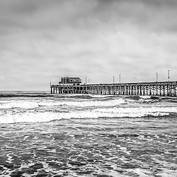 Newport Beach Pier California panoramic photo in black and white. Panoramic photo ratio is 1:3. Newport Pier is a popular attraction in Newport Beach California, an affluent coastal beach community along the Pacific Ocean in Orange County Southern California.