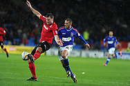 Cardiff city's Ben Turner (l) holds off Michael Chopra of Ipswich ®. NPower championship, Cardiff city v Ipswich Town at the Cardiff city Stadium in Cardiff, South Wales on Saturday 12th Jan 2013. pic by Andrew Orchard, Andrew Orchard sports photography,