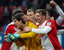 21.02.2015, SGL Arena, Augsburg, GER, 1. FBL, FC Augsburg vs Bayer 04 Leverkusen, 22. Runde, im Bild Torjubel nach dem 2:2 Ausgleich durch Marwin Hitz (Torwart FC Augsburg #35, gelb), Raul Bobadilla (FC Augsburg #25, verdeckt.), Ragnar Klavan (FC Augsburg #5), Jan-Ingwer Callsen-Bracker (FC Augsburg #18) // during the German Bundesliga 22nd round match between FC Augsburg and Bayer 04 Leverkusen at the SGL Arena in Augsburg, Germany on 2015/02/21. EXPA Pictures © 2015, PhotoCredit: EXPA/ Eibner-Pressefoto/ Krieger<br /> <br /> *****ATTENTION - OUT of GER*****