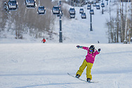 CarrieAnn Grayson plays on her snowboard at Snowmass.