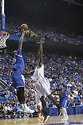 Kentucky Alum DeMarcus Cousins, left, blocks a shot by North Carolina Alum Harrison Barnes in the second half.  The Kentucky Alumni Men's Basketball team hosted the University of North Carolina Alumni in a charity game, Sunday, Sept. 13, 2015 at Rupp Arena in Lexington. <br /> <br /> Photo by Jonathan Palmer