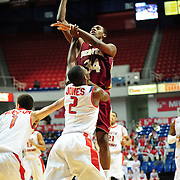 Denver's forward, Chris Udofia (34), shoots over South Alabama's guard Dallas Jones (2) in the first half of play in Mobile, AL. Denver leads South Alabama 30-24 at halftime on January 7, 2012...