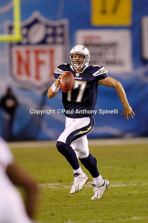 San Diego Chargers quarterback Philip Rivers (17) runs for a first down on third and long during the third quarter of the NFL week 11 football game against the Denver Broncos on Monday, November 22, 2010 in San Diego, California. The Chargers won the game 35-14. (©Paul Anthony Spinelli)