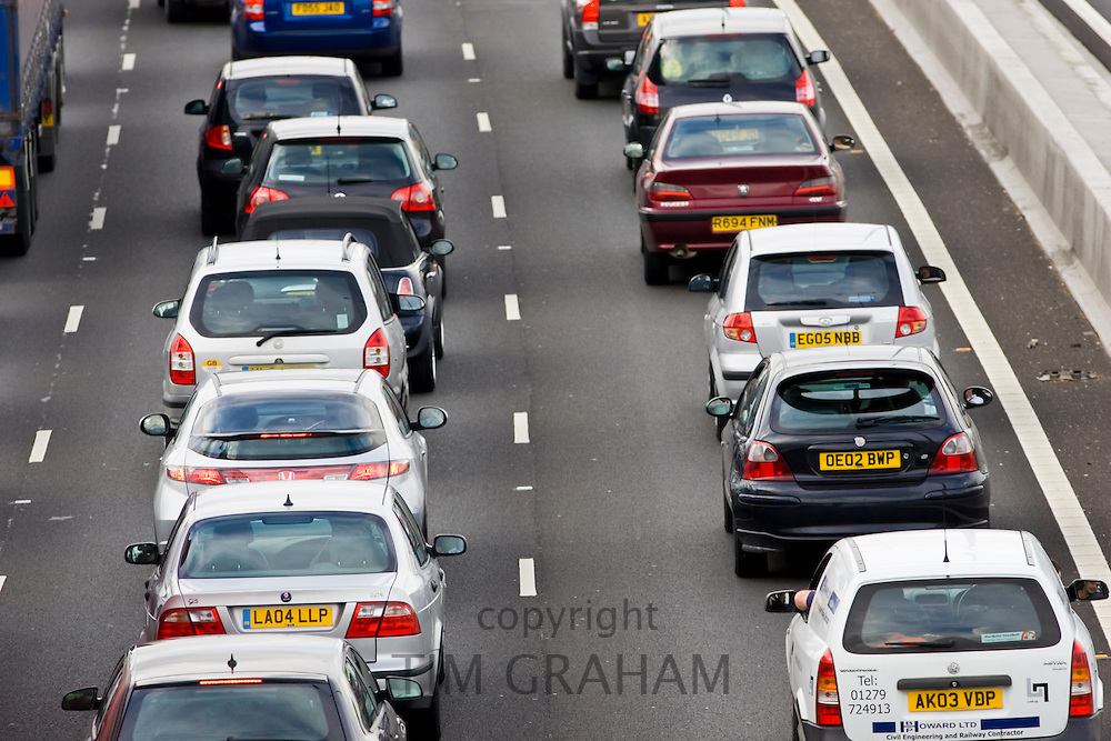 Saloon cars bumper-to-bumper in traffic congestion on M25 motorway, London, United Kingdom