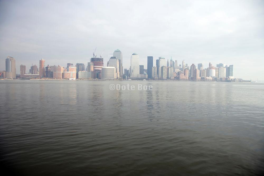 down town Manhattan in a slight haze seen from the New Jersey side