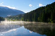 Parkhotel Tristacher See, Tyrol, Austria. Morning mist on the lake.