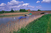 A08BNF Small boats and reed banks on the River Ore Snape bridge Suffolk England