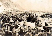Russo-Japanese War 1904-1905: Japanese and Korean coolies removing supplies from the wharf at Chemulpo, Korea, 1904.