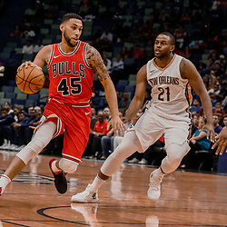 Oct 3, 2017; New Orleans, LA, USA; Chicago Bulls guard Denzel Valentine (45) drives past New Orleans Pelicans forward Darius Miller (21) during the first half of a NBA preseason game at the Smoothie King Center. Mandatory Credit: Derick E. Hingle-USA TODAY Sports