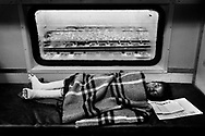 "A kid after an operation of polio is resting inside the hospital train Life Line Express. Jharkhand state. India<br /> --<br /> (Bura Sapna minds ""nightmare"" in Hindi.) <br /> <br /> India, with its 1,25 billion people is the second most populous country in the world and one of the fastest booming economies. However, despite the incredible economic growth, it has still the largest share of poor people in the world: 42 per cent of its population still lives below the poverty threshold (1,25 US dollars per day).  India is mainly rural, with two thirds of its population living in rural areas, where the access to health services is very limited and obsolete: hospitals have scarce resources and waiting lists can be eternal. Significant disparities among states and social groups make the poor, tribes, girls and lower casts the most vulnerable and affected by the lack of a proper care.  This work is a journey inside a hospital train traveling through the poorest Indian states, exploring the most isolated hospitals where extreme poverty afflicts without mercy and affects more than half of the population. <br /> --"