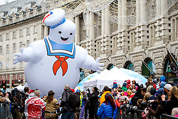 © Licensed to London News Pictures. 20/11/2016. London, UK. A giant Marshmallow Man and over 400 cast members of Hamley's Toy Parade march along Regent Street in London in a colourful extravaganza, with marching bands, dancers and toy vehicles. Photo credit: Tolga Akmen/LNP