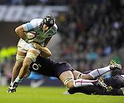 Twickenham, GREAT BRITAIN, Joe WORSLEY, with a low tackle on Patricio ALBACETE, during closing minutes of the second half of the Investic Challenge Series, England vs Argentina, Autumn International at Twickenham Stadium, Surrey on Sat 14.11.2009 [Photo, Peter Spurrier/Intersport-images]