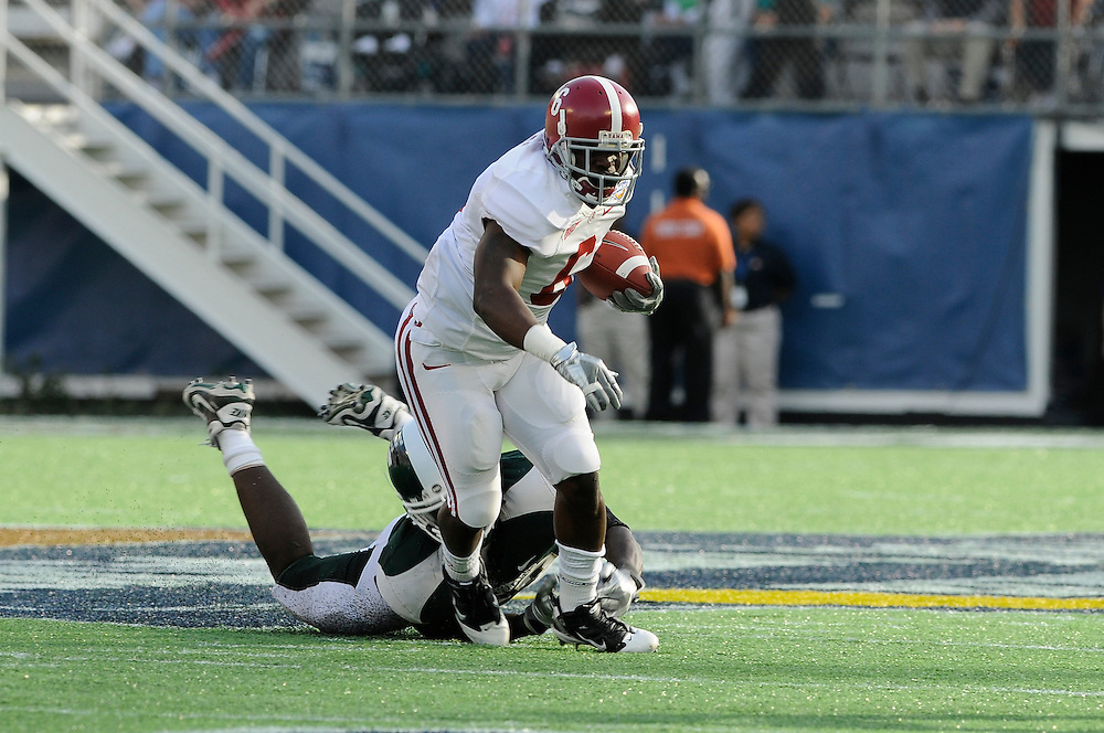 January 1, 2011: Demetrius Goode of the Alabama Crimson Tide avoids the attempted tackle from Greg Jones of the Michigan State Spartans during the NCAA football game between Michigan State Spartans and the Alabama Crimson Tide at the 2011 Capital One Bowl in Orlando, Florida. Alabama defeated Michigan State 49-7.