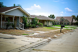 28 August 2014. Braithwaite, Louisiana.<br /> Hurricane Isaac 2 years later. <br /> Storms don't discriminate. The once predominantly white middle class neighborhood of Braithwaite Park, established in 1936 remains eerie and abandoned as residents failed to return following the flooding and subsequent chemical spill from nearby Stolthaven chemical storage facility.  Insurance companies have often refused to pay residents the full value on their policies and many are now in litigation. Houses once valued at well over $250,000 are rapidly falling into disrepair and blight. Hurricane Isaac struck on August 29th 2012.<br /> Photo; Charlie Varley