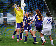 11 MAY 2012 -- ALTON, Ill. -- Civic Memorial High School soccer goalie Addie Ballard leaps to make a save during Civic's game with Alton Marquette High School during the Class 1A Regional Finals at Gordon Moore Park in Alton Friday, May 11, 2012. Photo © copyright 2012 Sid Hastings.