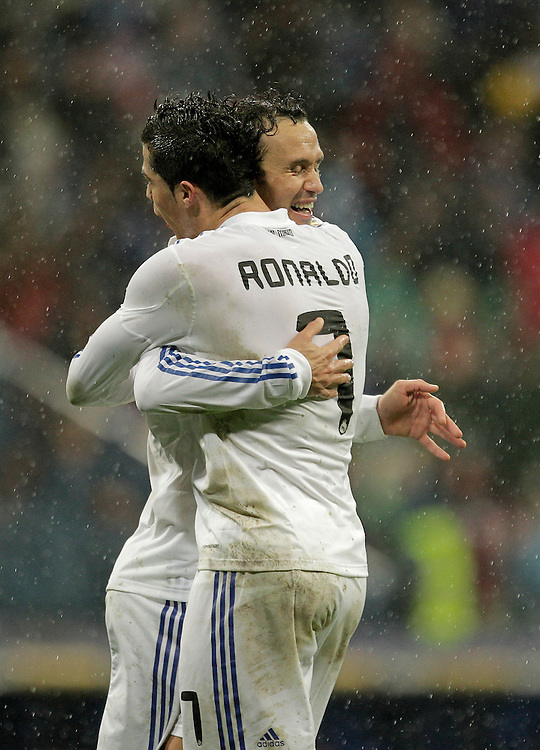 Real Madrid's Ricardo Carvalho from Portugal, left, reacts after scoring against Levante with Cristiano Ronaldo from Portugal, right, during a Spanish La Liga soccer match at the Santiago Bernabeu stadium in Madrid, Saturday, Feb. 19, 2011.