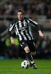 NEWCASTLE, ENGLAND - Tuesday, April 19, 2011: Newcastle United's Danny Guthrie in action against Manchester United during the Premiership match at St James' Park. (Photo by David Rawcliffe/Propaganda)