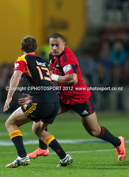 Crusaders' Robbie Fruean confronted by Chiefs' Andrew Horrell during the Super Rugby Semi Final won by the Chiefs (20-17) against the Crusaders at Waikato Stadium, Hamilton, New Zealand, Friday 27 July 2012. Photo: Stephen Barker/Photosport.co.nz