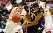 March 12, 2011:  Ohio State Buckeyes guard Aaron Craft (4) and Michigan Wolverines guard Darius Morris (4) battle for a loose ball during the Big Ten Men's basketball tournament at Conseco Fieldhouse in Indianapolis, IN. In the first half of the semi-final game between Michigan and Ohio State. Ohio State defeated Michigan 68-61.