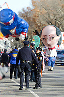 Police officers monitoring the crowd at the Macy's Thanksgiving Day Parade.