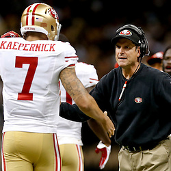 Nov 17, 2013; New Orleans, LA, USA; San Francisco 49ers quarterback Colin Kaepernick (7) celebrates with  head coach Jim Harbaugh following a touchdown pass against the New Orleans Saints during the second quarter of a game at Mercedes-Benz Superdome. Mandatory Credit: Derick E. Hingle-USA TODAY Sports