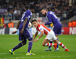 Arsenal's Alexis Sanchez challenges Anderlecht's Chancel Mbemba for the ball - Photo mandatory by-line: Dougie Allward/JMP - Mobile: 07966 386802 - 22/10/2014 - SPORT - Football - Anderlecht - Constant Vanden Stockstadion - R.S.C. Anderlecht v Arsenal - UEFA Champions League - Group D