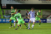 Cheltehham Town's Danny Whitehead tackles Forest Green Rovers Fabien Robert (26) during the Gloucestershire Senior Cup match between Forest Green Rovers and Cheltenham Town at the New Lawn, Forest Green, United Kingdom on 20 September 2016. Photo by Shane Healey.