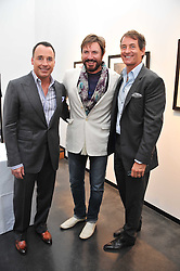 Left to right, DAVID FURNISH, SIMON LE BON and TIM JEFFERIES at a private view of photographs by Herb Ritts held at Hamiltons Gallery, 13 Carlos Place, London on 21st June 2011.