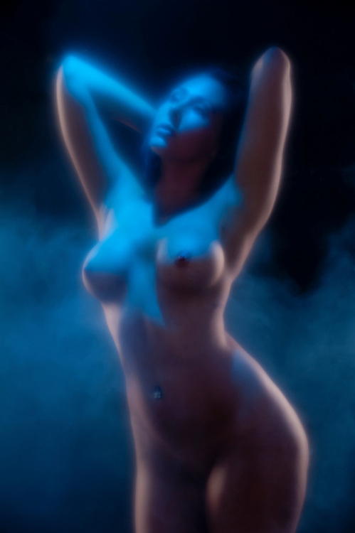 Ethereal concept of a nude woman with fog.