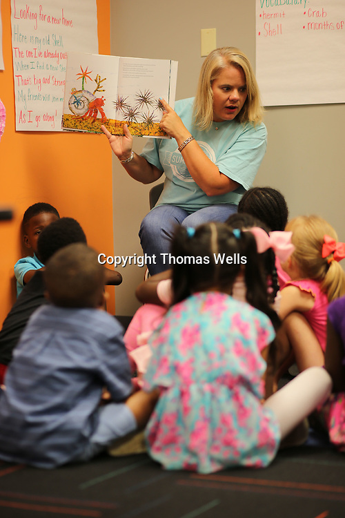"Robin Maynard points out sea ceatures as she students the book ""A house for a hermit crap"" during Monday's Summer S.A.L.T. program at The Orchard."