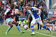 Blackburn Rovers Forward, Sam Gallagher (19) and Aston Villa Midfielder, Leandro Bacuna (7)  during the EFL Sky Bet Championship match between Blackburn Rovers and Aston Villa at Ewood Park, Blackburn, England on 29 April 2017. Photo by Mark Pollitt.