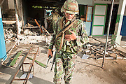 "Sept. 29, 2009 -- YARANG, THAILAND: A Thai soldier turns away after seeing the results of a mysterious explosion in an elementary school office in rural Pattani province, Sept. 29. Muslim militants frequently target schools because they claim the public schools are a symbol of the Bangkok government. No one was hurt in the explosion and the official cause of the blast was undetermined.  Thailand's three southern most provinces; Yala, Pattani and Narathiwat are often called ""restive"" and a decades long Muslim insurgency has gained traction recently. Nearly 4,000 people have been killed since 2004. The three southern provinces are under emergency control and there are more than 60,000 Thai military, police and paramilitary militia forces trying to keep the peace battling insurgents who favor car bombs and assassination.   Photo by Jack Kurtz / ZUMA Press"