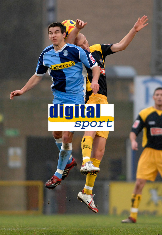 Photo: Richard Lane.<br />Wycombe Wanderers v Stockport County. Coca Cola League 2. 23/12/2006. <br />Wycombe's Matt Bloomfield challenges Stockport's Jason Taylor.