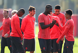 Paul Pogba of Manchester United shares a joke with Jesse Lingard - Mandatory by-line: Matt McNulty/JMP - 14/09/2016 - FOOTBALL - Manchester United - Training session ahead of Europa League Group A match against Feyenoord