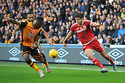 Hull City midfielder Moses Odubajo and George Friend of Middlesbrough FC during the Sky Bet Championship match between Hull City and Middlesbrough at the KC Stadium, Kingston upon Hull, England on 7 November 2015. Photo by Ian Lyall.