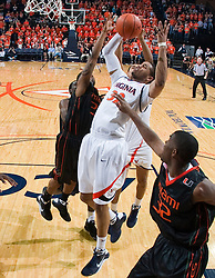 Virginia forward Mike Scott (32) battles for a rebound against Miami.  The Virginia Cavaliers fell to the Miami Hurricanes 62-55 at the John Paul Jones Arena on the Grounds of the University of Virginia in Charlottesville, VA on February 26, 2009.
