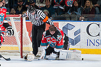 KELOWNA, CANADA - MARCH 18: Jackson Whistle #1 of Kelowna Rockets gets up off the ice after a collision with a player of the Seattle Thunderbirds on March 18, 2015 at Prospera Place in Kelowna, British Columbia, Canada.  (Photo by Marissa Baecker/Shoot the Breeze)  *** Local Caption *** Jackson Whistle;