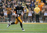 September 3, 2011: Iowa Hawkeyes quarterback James Vandenberg (16) scrambles for yards during the first half of the game between the Tennessee Tech Golden Eagles and the Iowa Hawkeyes at Kinnick Stadium in Iowa City, Iowa on Saturday, September 3, 2011. Iowa defeated Tennessee Tech 34-7 in a game stopped at one point due to lightning and rain.