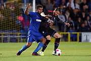 AFC Wimbledon defender Reuben Collins (36) battles for possession with Crystal Palace Connor Wickham (21) during the Pre-Season Friendly match between AFC Wimbledon and Crystal Palace at the Cherry Red Records Stadium, Kingston, England on 30 July 2019.
