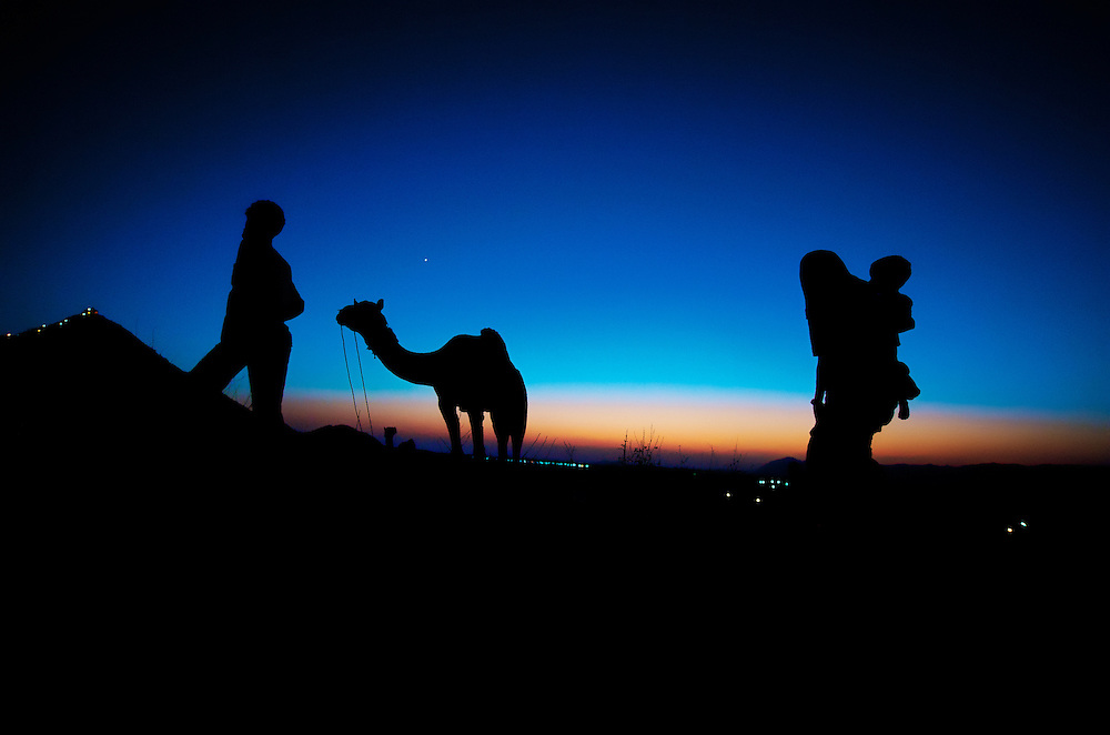 A couple walking back to their place after a busy day in the Pushkar Camel Fair, Rajasthan.
