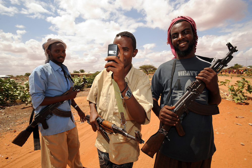 A Somali militia takes a picture with his mobile phone in the Somali town of Bulla Howa on the Somali Kenyan border. 26/6/2008