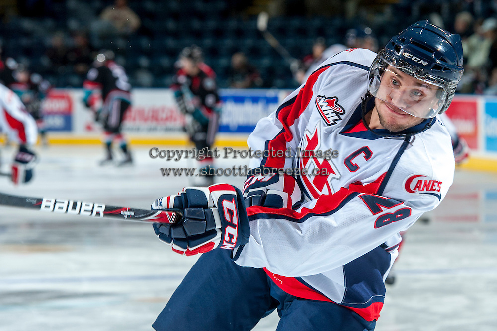 KELOWNA, CANADA - OCTOBER 16: Joshua Derko #28 of the Lethbridge Hurricanes takes a shot during warm up against the Kelowna Rockets on October 16, 2013 at Prospera Place in Kelowna, British Columbia, Canada.   (Photo by Marissa Baecker/Shoot the Breeze)  ***  Local Caption  ***