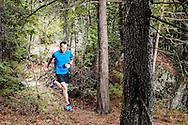 Male trail runner outside.