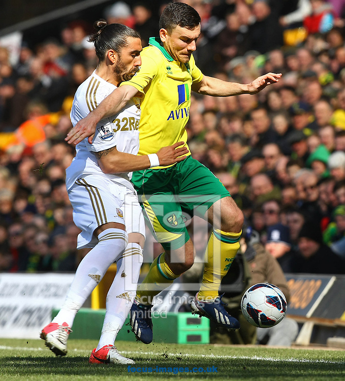 Picture by Paul Chesterton/Focus Images Ltd +44 7904 640267.06/04/2013.Robert Snodgrass of Norwich and Chico Flores of Swansea in action during the Barclays Premier League match at Carrow Road, Norwich.
