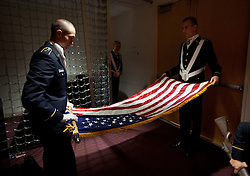 ROTC Honor Guard members roll the flag after the Veterans Day ceremony at PLU on Wednesday, Nov. 11, 2015. (Photo/John Froschauer/PLU)