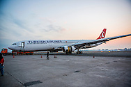 The nose of the crashed Turkish Airlines Airbus 330 (flight TK726) plane rests on a flatbed tow truck several days after it slid off the tarmac at Kathmandu's Tribhuvan International Airport (TIA).