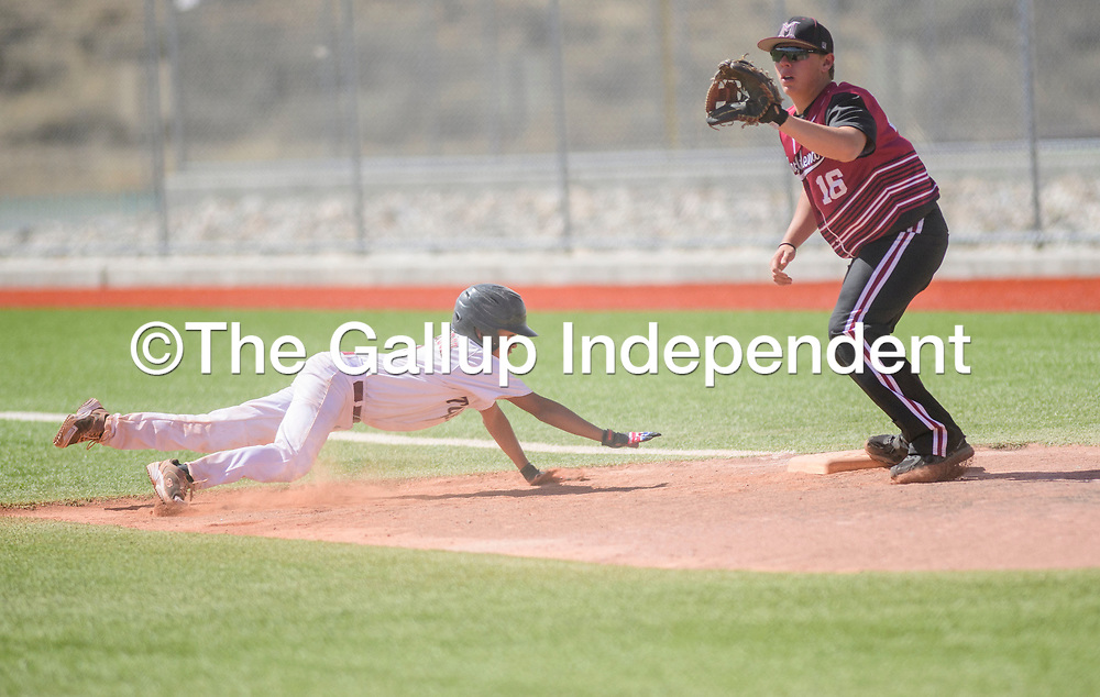 Tohatchi Cougar Ezra Benally (3) dives back to first base before Magdalena Steer Will Montoya (16) receives the throw at the Gallup Sports Complex Thursday.