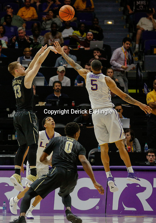 Feb 20, 2018; Baton Rouge, LA, USA; Vanderbilt Commodores guard Riley LaChance (13) shoots over LSU Tigers guard Daryl Edwards (5) during the second half at the Pete Maravich Assembly Center. LSU defeated Vanderbilt 88-78. Mandatory Credit: Derick E. Hingle-USA TODAY Sports