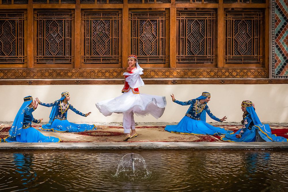 Young school girls put on a spectacular performance of traditional folklore dance at the Sheki Khan palace grounds.